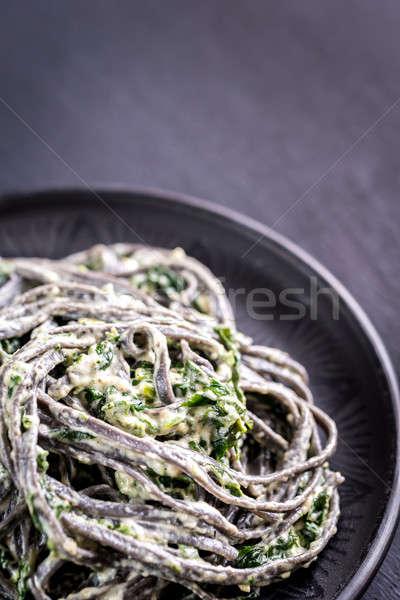Negro pasta espinacas mascarpone parmesano fondo Foto stock © Alex9500