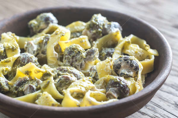 Portion of creamy mushroom pasta with pesto Stock photo © Alex9500