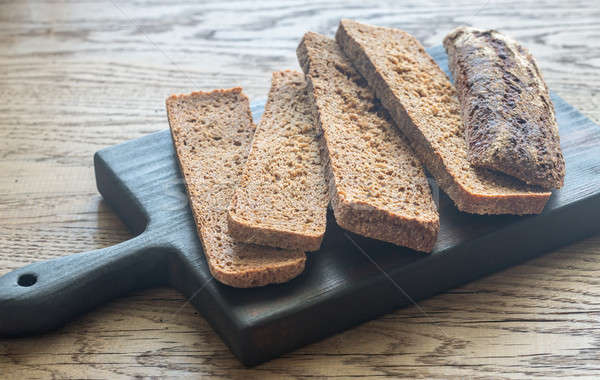 Slices of rye bread on the wooden board Stock photo © Alex9500