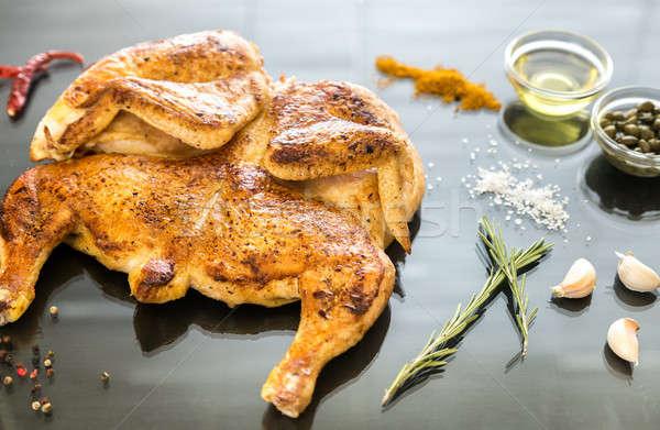 Grilled chicken with ingredients on the dark wooden background Stock photo © Alex9500