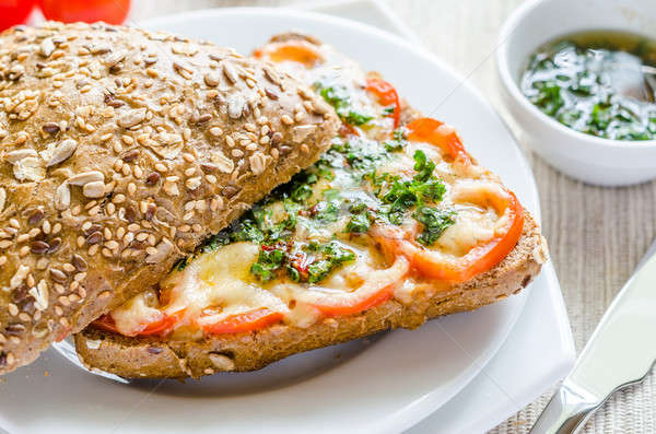 Sandwich with melted cheese and tomatoes Stock photo © Alex9500