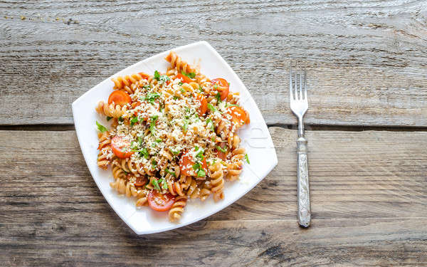 Whole heat fusilli pasta with cheese and cherry tomatoes Stock photo © Alex9500