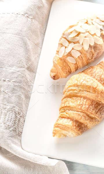 Croissantok fehér tányér felső kilátás asztal Stock fotó © Alex9500