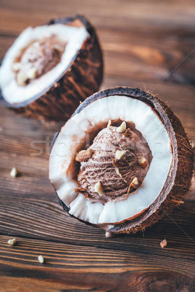 Chocolate ice cream in the coconut halves Stock photo © Alex9500