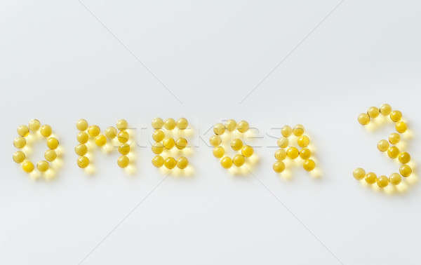 Omega-3 fish oil capsules on the white background Stock photo © Alex9500