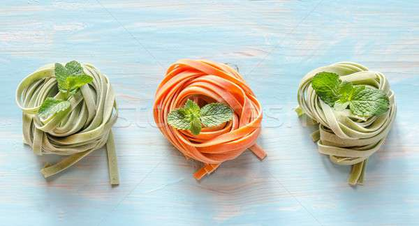 Colorful rolled pasta on the wooden background Stock photo © Alex9500