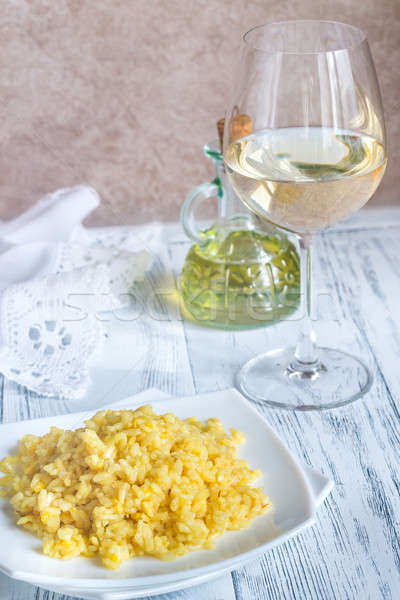 Portion of risotto with glass of white wine Stock photo © Alex9500
