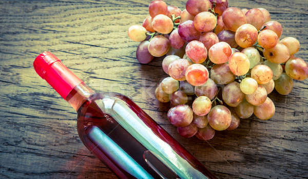 Glass of rose wine with bunch of grape Stock photo © Alex9500