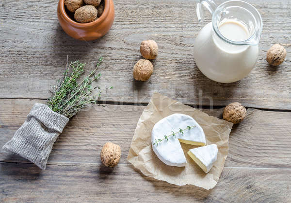 Camembert with pitcher of milk and whole nuts Stock photo © Alex9500