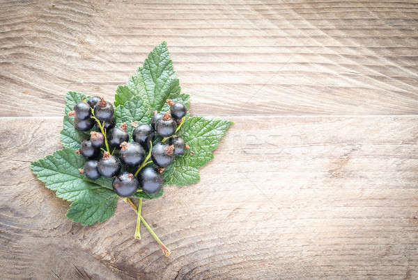 Fresh blackcurrant on leaves on the wooden board Stock photo © Alex9500