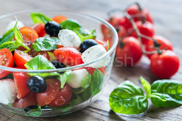 Stock photo: Salad with tomatoes, olives, mozzarella and basil