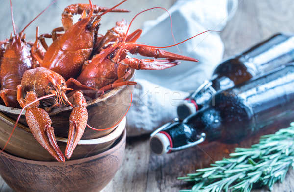 Bowl of boiled crayfish with bottles of beer Stock photo © Alex9500