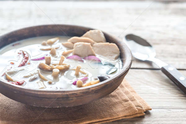 Bowl of thai tom kha kai soup Stock photo © Alex9500