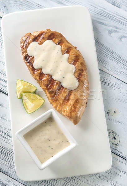 Grilled turkey breast with sauce and lime slice Stock photo © Alex9500