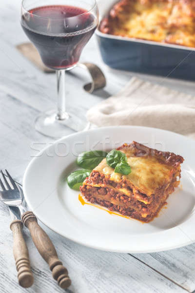 Portion of lasagne with a glass of wine Stock photo © Alex9500