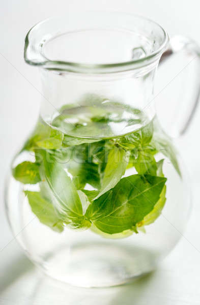 Water with fresh basil in the glass jug Stock photo © Alex9500