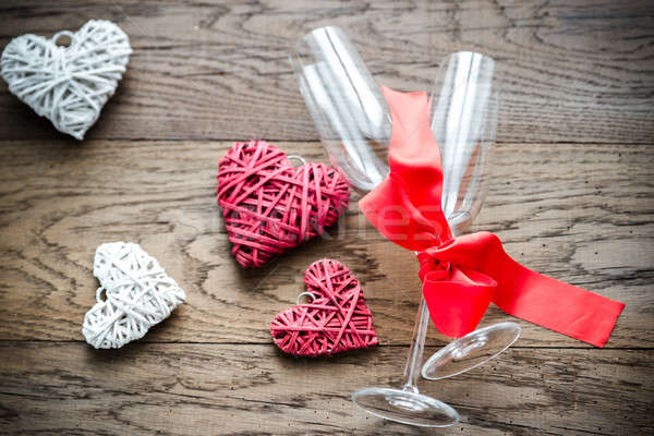 Two flutes with retro cane hearts on the wooden background Stock photo © Alex9500
