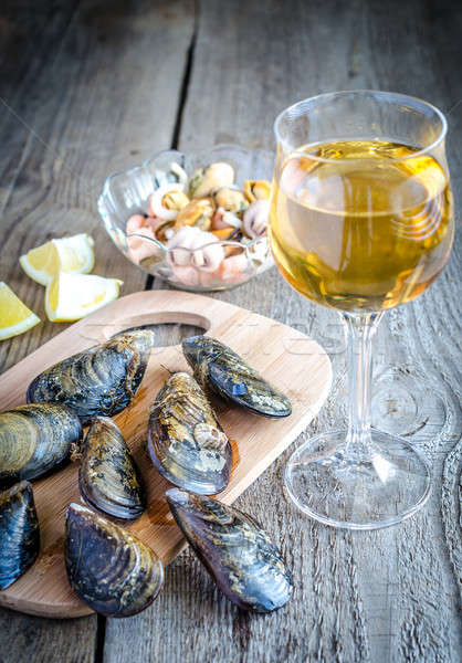 Mussels with a glass of white wine on the wooden table Stock photo © Alex9500