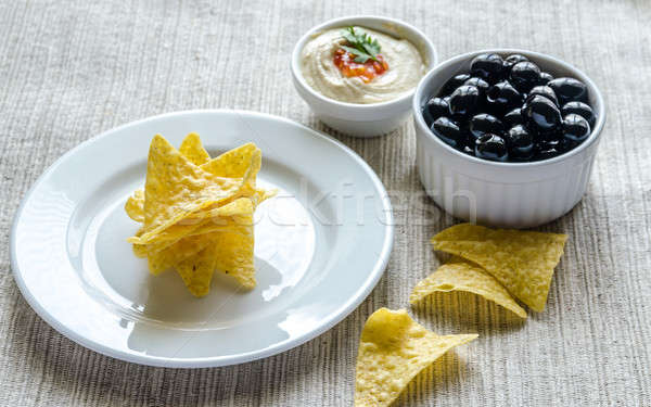 Corn chips with hummus and olives Stock photo © Alex9500