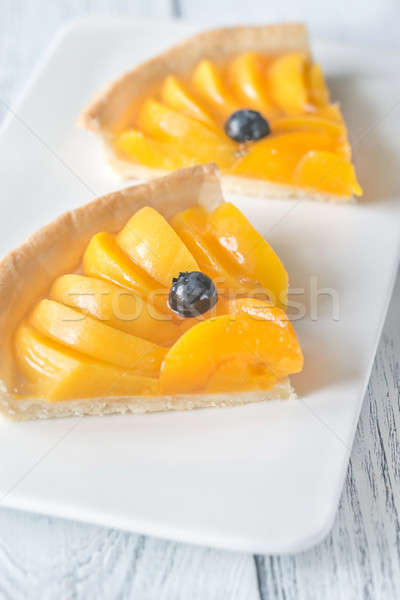 Rebanadas tarta duraznos arándano frutas verano Foto stock © Alex9500