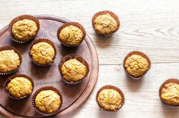 Sütőtök muffinok mazsola narancs asztal kenyér Stock fotó © Alex9500
