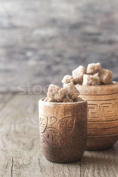 Bowls of brown sugar on the wooden background Stock photo © Alex9500