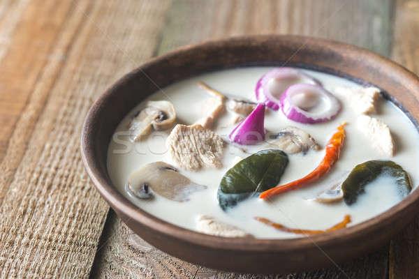 Bowl of thai tom kha kai soup Stock photo © Alex9500