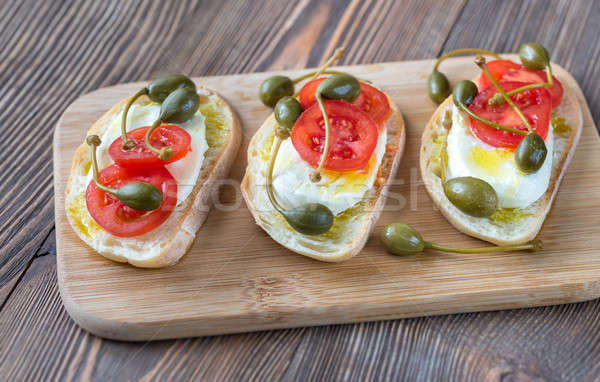 Ciabatta with mozzarella, tomatoes and capers Stock photo © Alex9500