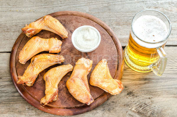 Smoked chicken wings with spicy sauce and glass of beer Stock photo © Alex9500