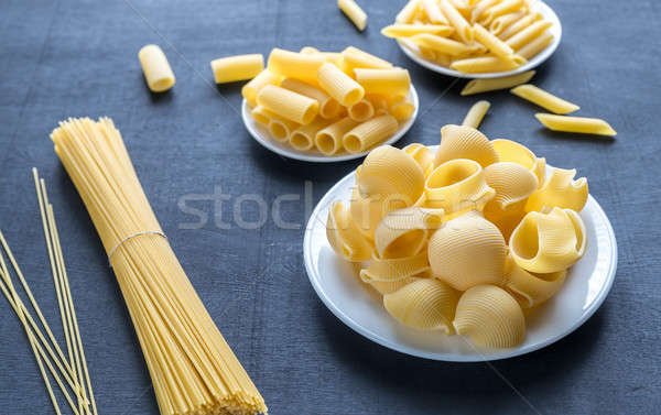 Various types of pasta on the dark background Stock photo © Alex9500