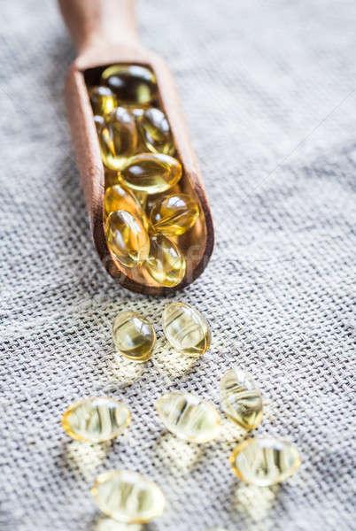 Omega3 capsules houten schep glas koepel Stockfoto © Alex9500
