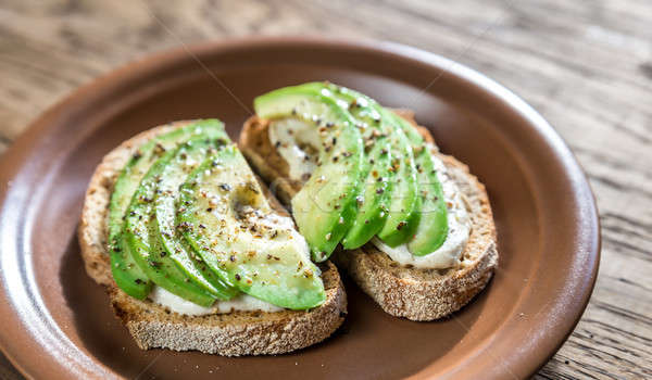 Toasts with tahini sauce and sliced avocado Stock photo © Alex9500