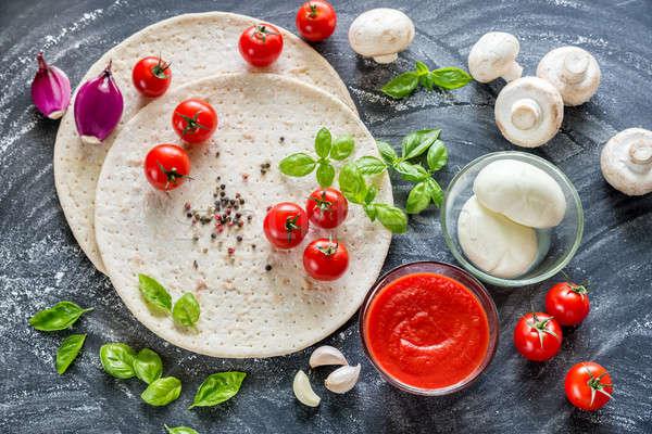 Pizza ingredients on the dark wooden background Stock photo © Alex9500