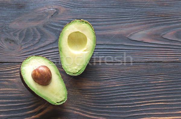 Halved avocado on the wooden background Stock photo © Alex9500