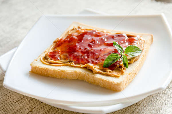 Sandwich with peanut butter and strawberry jelly Stock photo © Alex9500