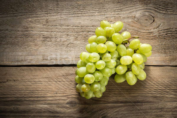 Bunch of white grape on the wooden background Stock photo © Alex9500