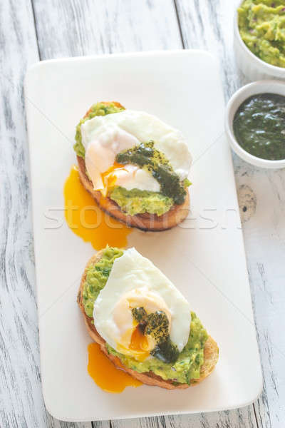 Sandwiches with guacamole and poached eggs Stock photo © Alex9500