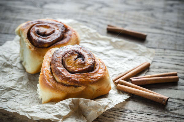 Cinnamon roll on the wooden background Stock photo © Alex9500