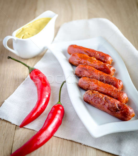 Roasted sausages with mustard sauce Stock photo © Alex9500