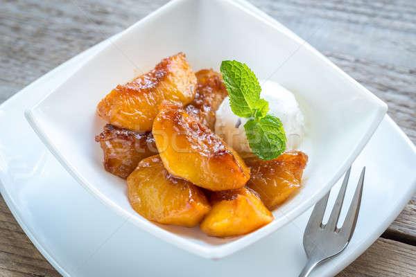 Caramelized peaches with vanilla ice cream Stock photo © Alex9500