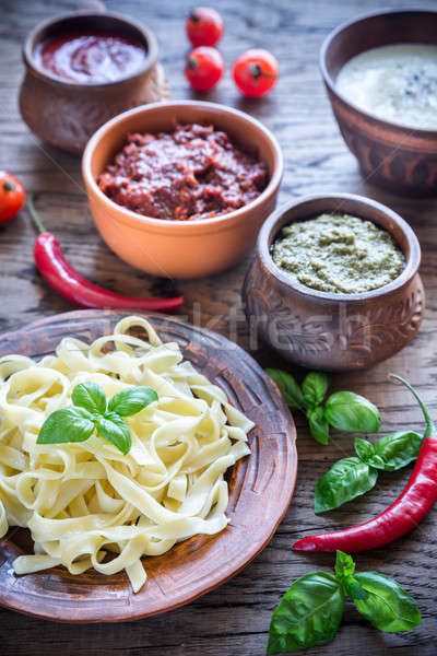 Tagliatelle with different kinds of sauce Stock photo © Alex9500