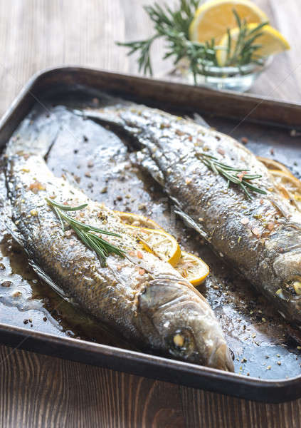 Baked sea bass with lemon and rosemary Stock photo © Alex9500