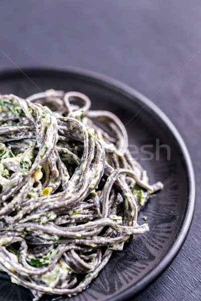 Fekete tészta spenót mascarpone parmezán háttér Stock fotó © Alex9500