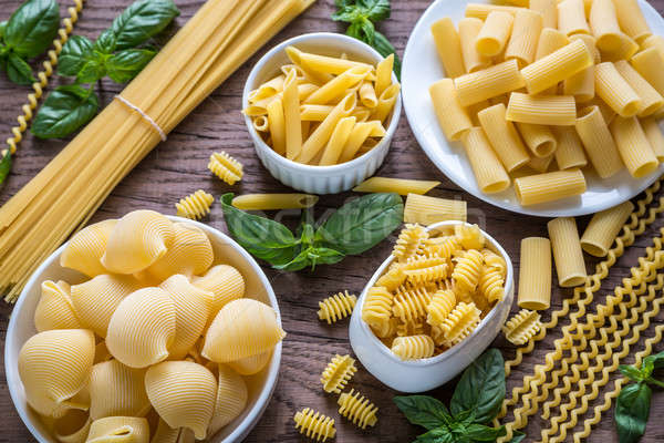 Various types of pasta on the wooden background Stock photo © Alex9500