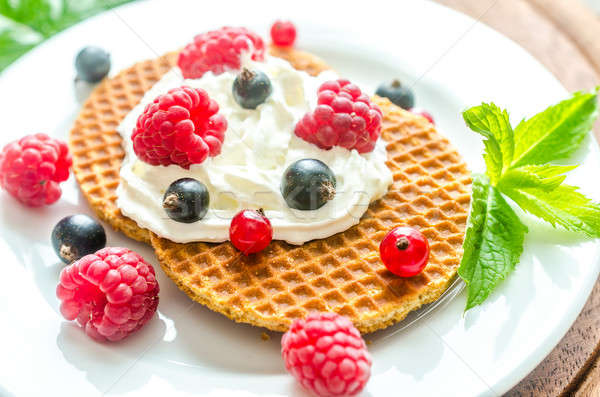 Belgian waffles with whipped cream and fresh berries Stock photo © Alex9500