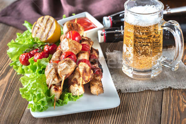 Grilled chicken skewers with mug of beer Stock photo © Alex9500