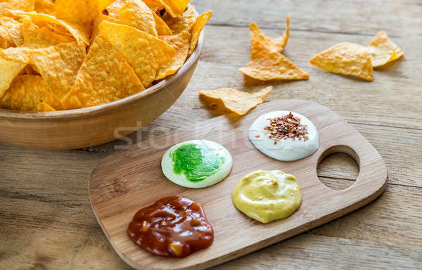 Cheese nachos with different types of sauce Stock photo © Alex9500