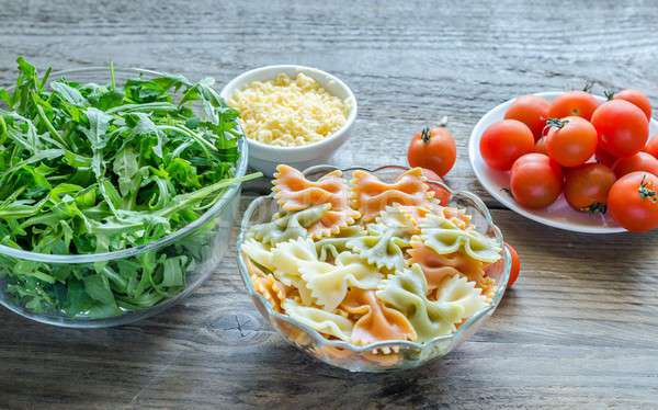 Tricolore farfalle with arugula, parmesan and cherry tomatoes Stock photo © Alex9500