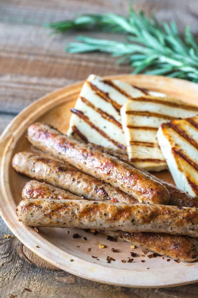 Grilled sausages and cheese with rosemary Stock photo © Alex9500