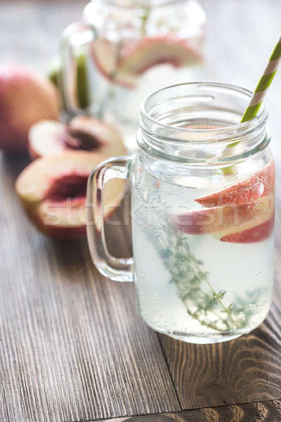 Glass jar of lime water with slices of peach Stock photo © Alex9500